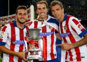 Koke, Godín y Mandžukić posan con el títlulo| Club Atlético de Madrid